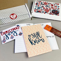 Patterned hand lettered journal, bar of divine chocolate in Red & green Scandinavian designed gift box with gift tag