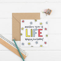 Another Year of Life square greetings card - primary colours with kraft envelope