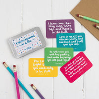 15 brightly coloured hand lettered scripture cards with encouraging scriptures presented in a slide-top tin