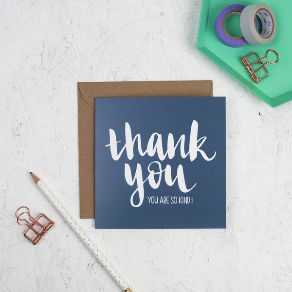 Hand lettered thank you square greeting card - white lettering on a dark blue card