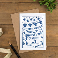 Folk style hand-drawn Christmas card in a muted blue printed on luxurious matte recycled card with scripture and charming illustrations
