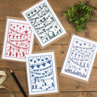 Set of four folk style hand-drawn Christmas cards in a muted colour palette printed on luxurious matte recycled card