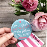 Large pocket mirror 76mm in diameter with a blue background and the words of Isaiah 49:16 hand-lettered in pink and white