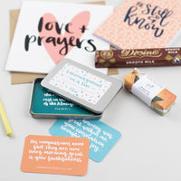 Thinking of you box with love & prayers card, divine chocolate, be still & know notebook, soap & encouragements in a tin