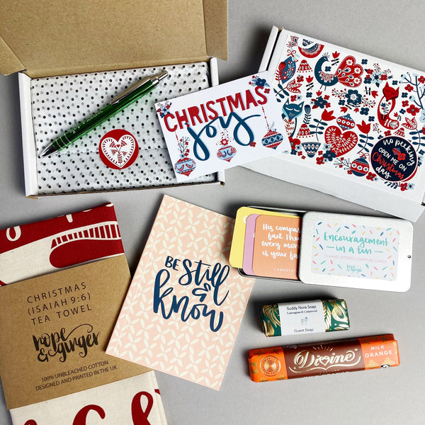 Red & green Scandinavian design festive gift box, tin of encouragements, journal, tea towel, pen, chocolate & soap