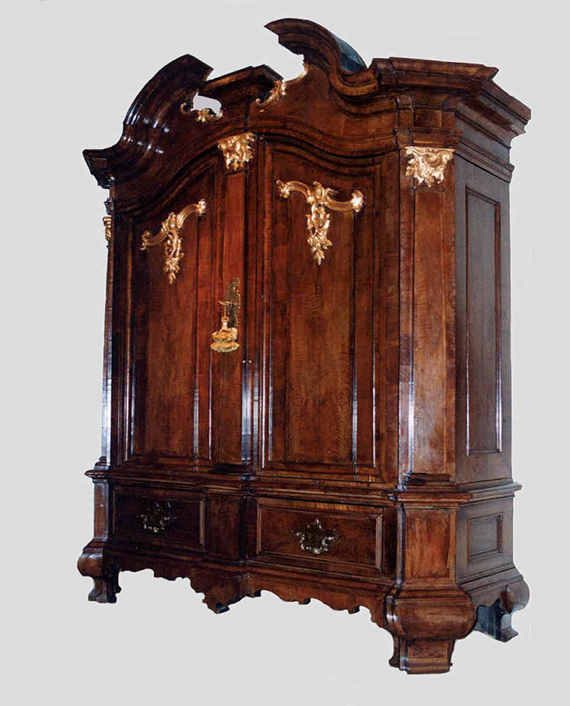 NORTH GERMAN ROCOCO WALNUT  AND PARCEL GILT CUPBOARD