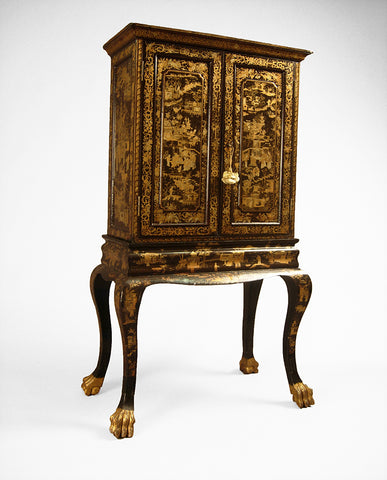 CHINESE EXPORT BLACK LACQUER AND CHINOISERIE CABINET ON STAND