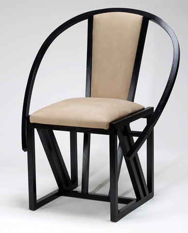 FRENCH EBONIZED AND LEATHER ARMCHAIR