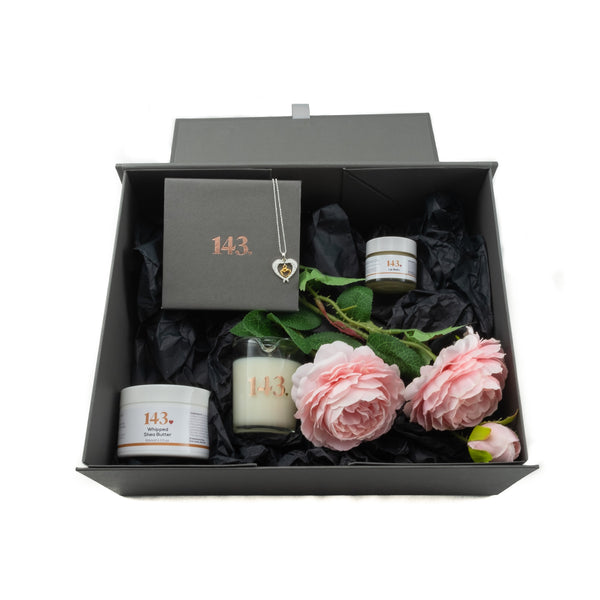 Me Time beautifully created box with all the gifts inside and a heart pendant of your choice