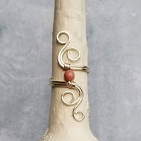 Cosmic Spiral Ring with Pink Rhodonite Stone