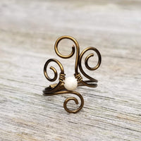 Flaming Spirals Ring with Cream Fossilized Shell Stone