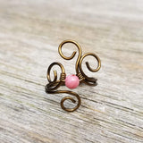Flaming Spiral Ring with Pink Rhodonite Stone