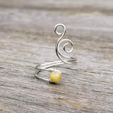 Whale Spout Spiral Ring with Rutile Quartz Stone