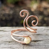 Whale Spout Spiral Ring with Cream Fossilized Shell Stone