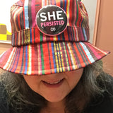 Sandra Yeyati of Good Eye Press LLC with She Persisted Pin