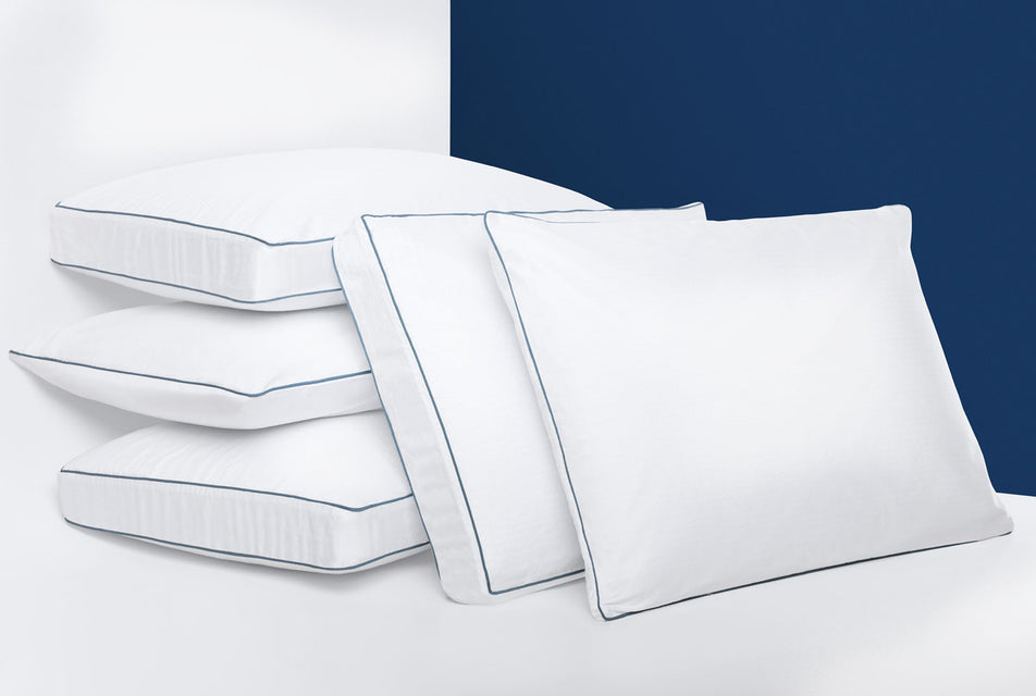 Photo of the 5 agility cool memory foam pillows, 3 stacked on top of each other and two leaning against the stacked pillows