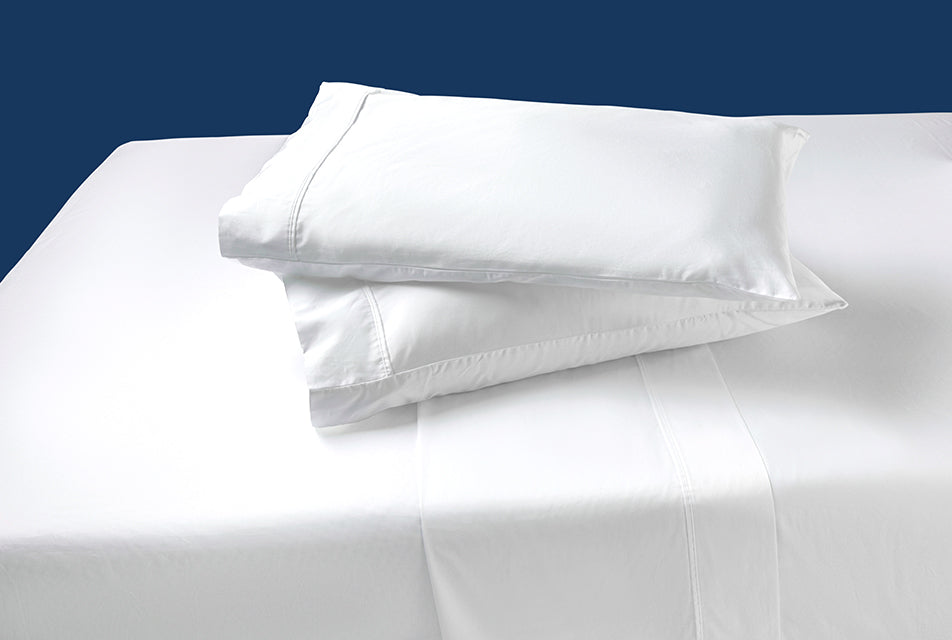 The agility sheet set with two agility pillows stacked on top of each other