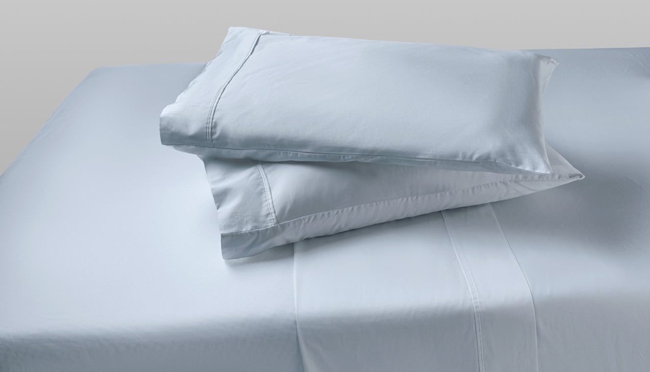 Sheet set with two pillows stacked on top of each other in Zen Blue