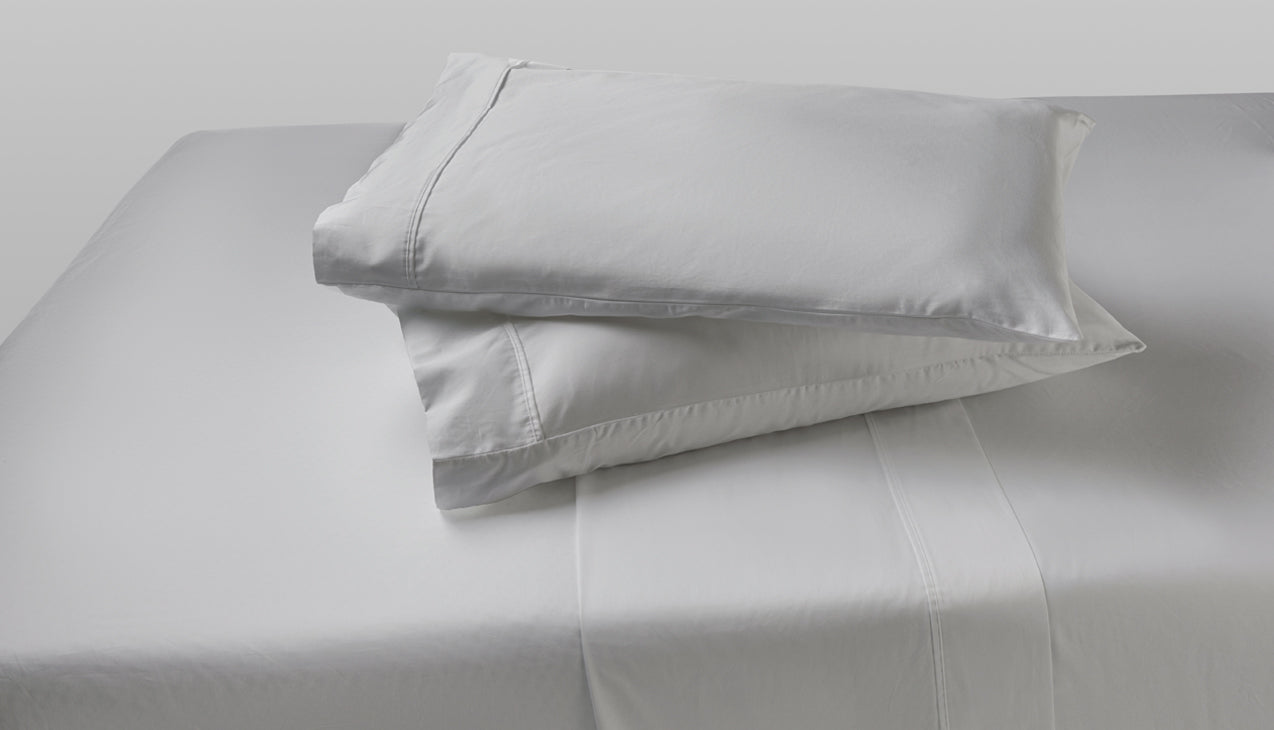 Sheet set with two pillows stacked on top of each other