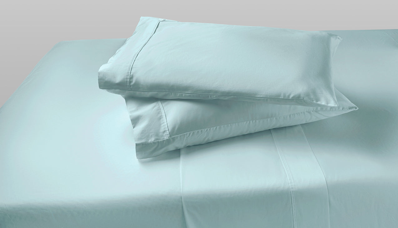 Sheet set with two pillows stacked on top of each other in Sterling Green color