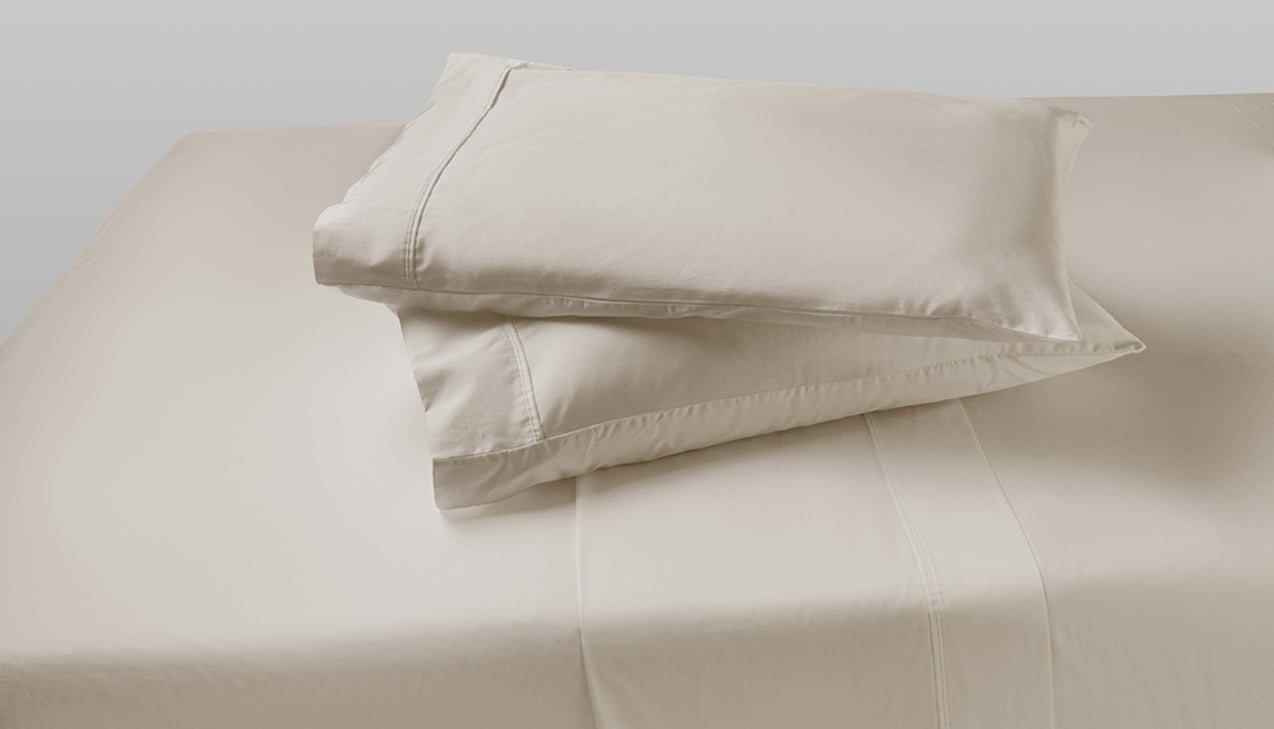 Sheet set with two pillows stacked on top of each other in Moonbeam Linen color