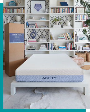 Agility mattress and shipping box in a room setting.