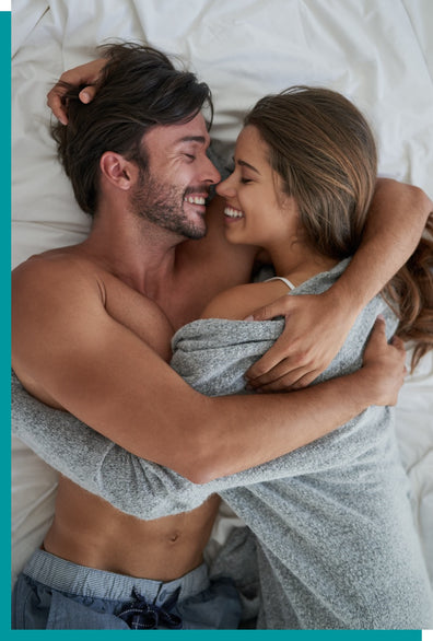 Happy couple embracing on a bed