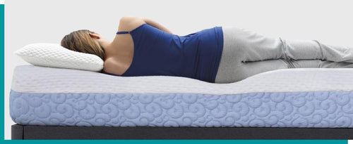 A woman lying down on her side on the agility mattress facing away
