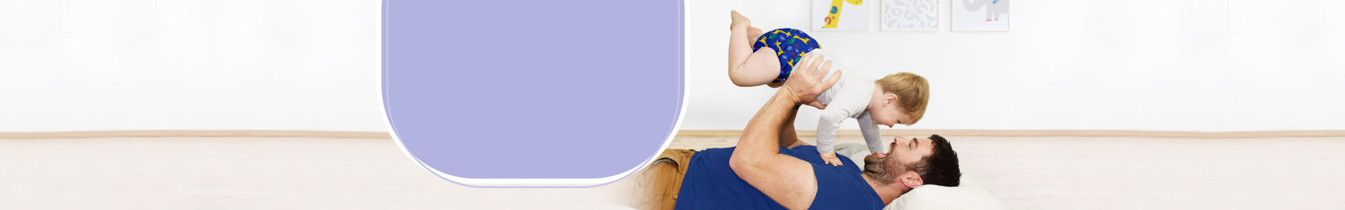 Bambino mio reusable nappies, dad laying down with baby