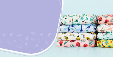 Reusable nappy sets banner with three stacks of reusable nappies