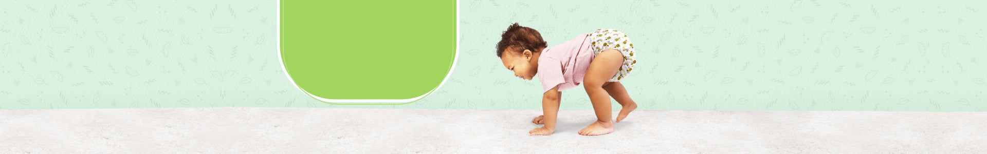 Reusable nappy week page banner with a baby crawling on hands and feet