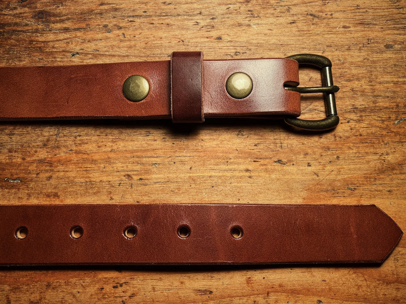 Full-grain leather belt, with solid brass hardware