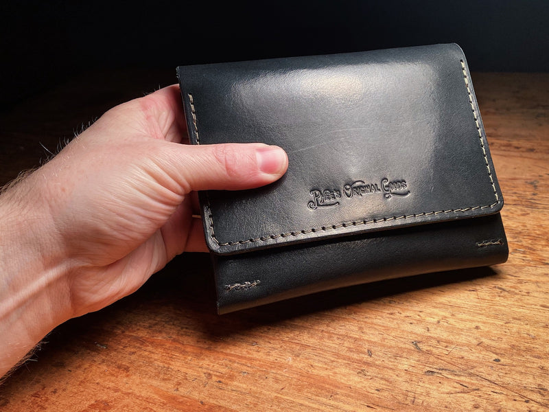 vegtable tanned black leather fly wallet, with debossed logo