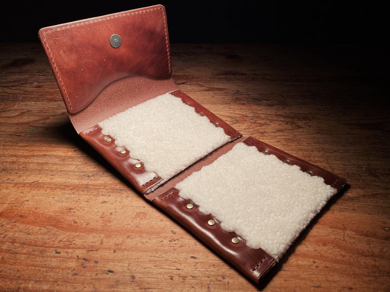 brown fly fishing wallet, with sheepskin liner, solid brass hardware
