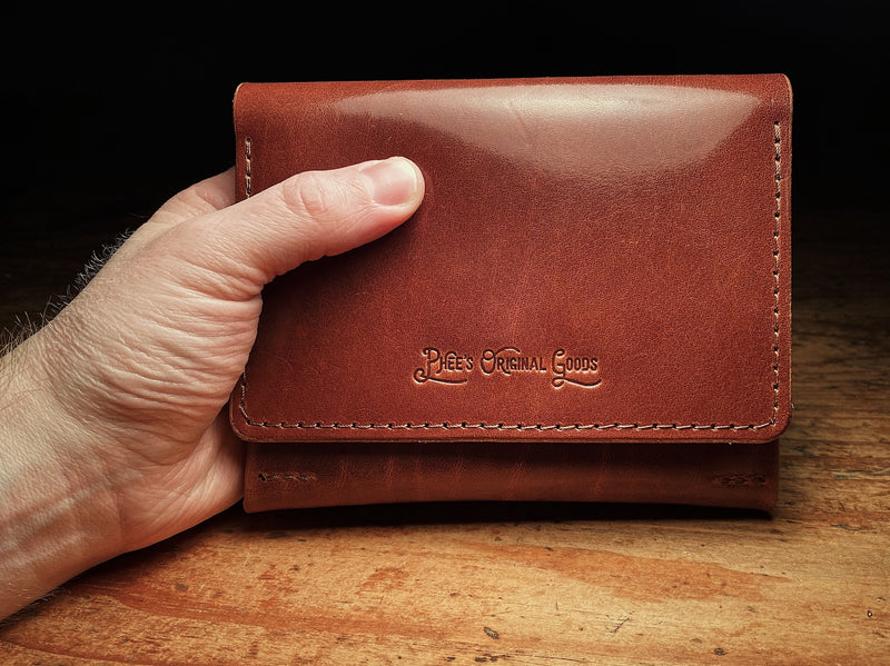 closed up fly fishing wallet in brown veg-tan leather