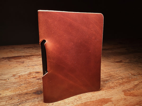 Front of notebook sleeve in full-grain brown veg tan leather
