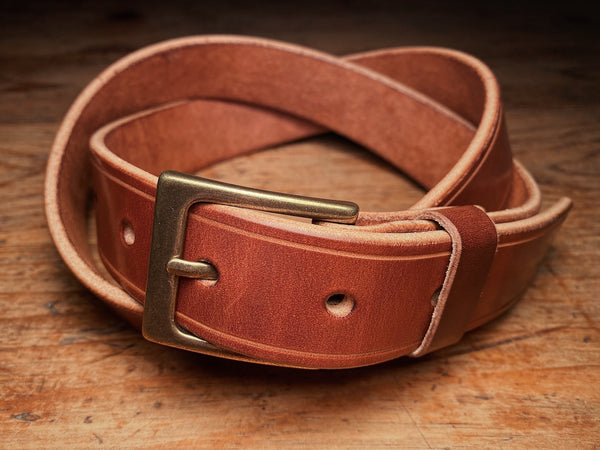 Full-grain brown harness leather sterling dress belt, knotted with solid brass buckle