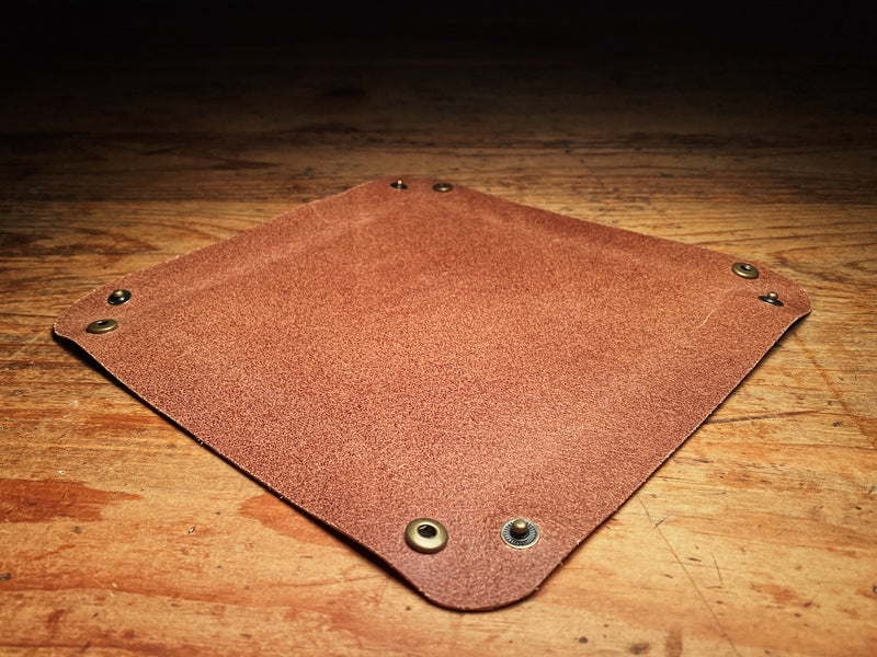 Packable, flat, unsnapped brown leather valet tray