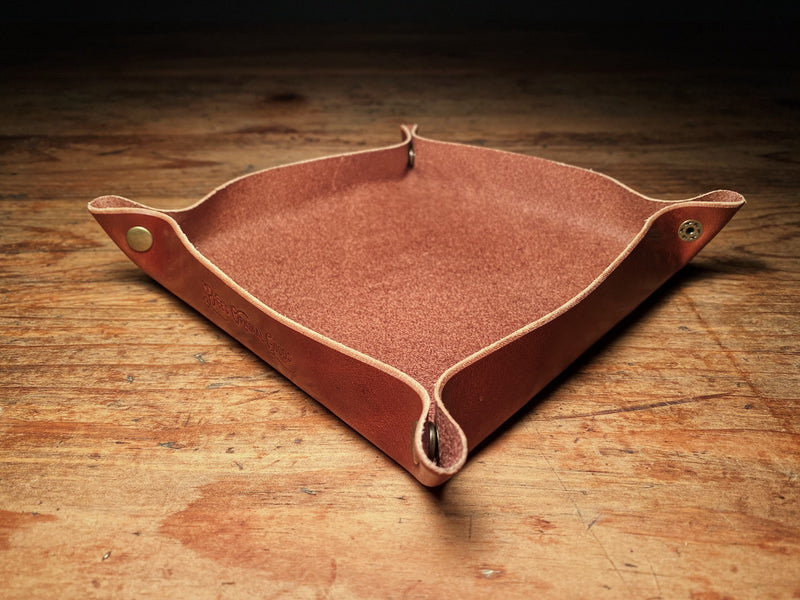 Full-grain leather valet tray in brown, with solid brass snaps