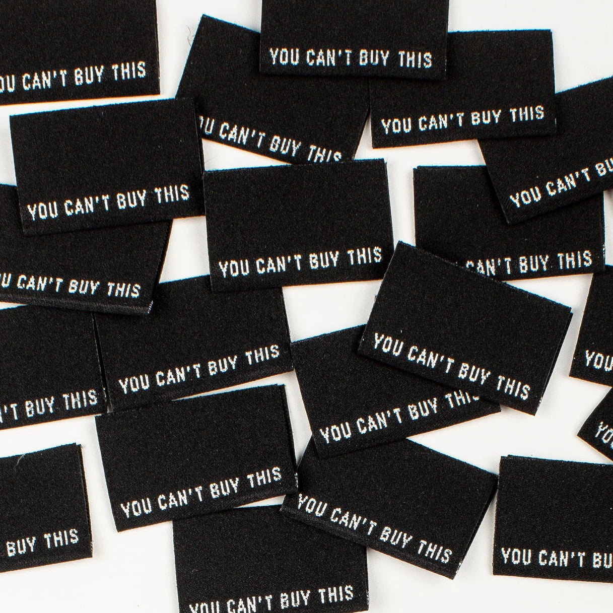 Kylie & The Machine - You Can't Buy This - Woven Labels 8 Pack