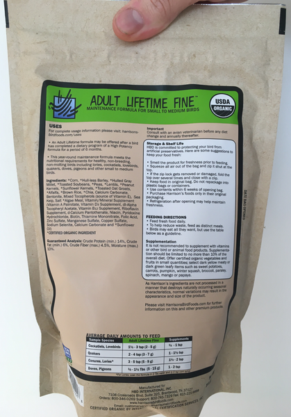 back of the green bag of Harrison's Adult Lifetime Fine premium pellets for parrots, shows feeding instructions, suitable for smaller birds