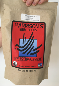 front of the small red bag of Harrison's High Potency Coarse premium pellets for parrots, suitable for larger birds with higher nutritional needs