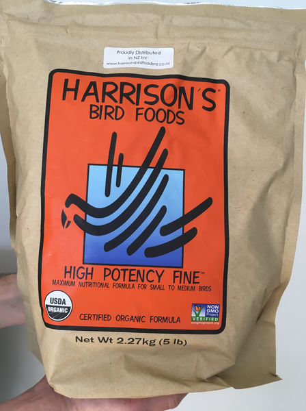 front of the large orange bag of Harrison's High Potency Fine premium pellets for parrots, suitable for smaller birds with higher nutritional needs