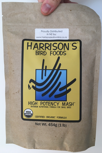 front of the small yellow bag of Harrison's High Potency Mash premium feed for small parrots, and doves, with higher nutritional needs