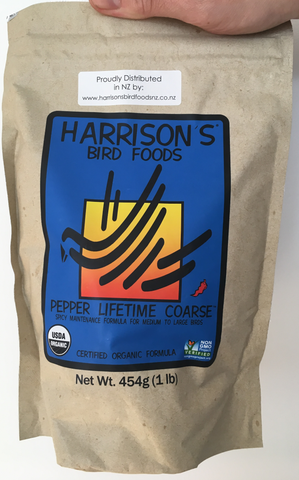 front of the small blue and orange bag of Harrison's Pepper Lifetime Coarse premium pellets for parrots, suitable for larger birds that like spicier food