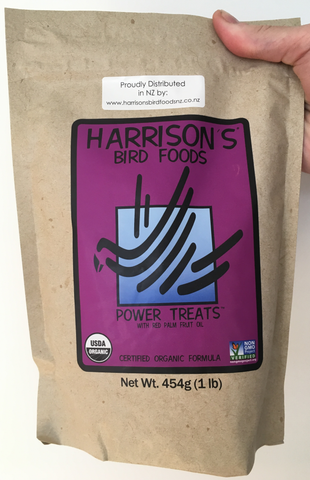 front of the small purple bag of Harrison's Power Treats, an excellent training aid and foraging treat