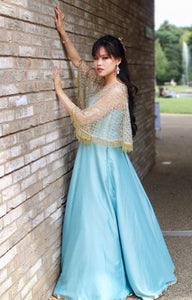 Gown in Sea Green with embellished Cape