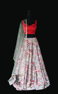Multicolored printed satin in fresh florals with a cowl neck satin blouse Lehenga Set