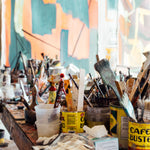 An artist's studio featuring paint brushes found at Art Factory.