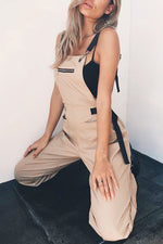 Casual Solid Paneled Buckle Pockets Foot-binding Jumpsuit